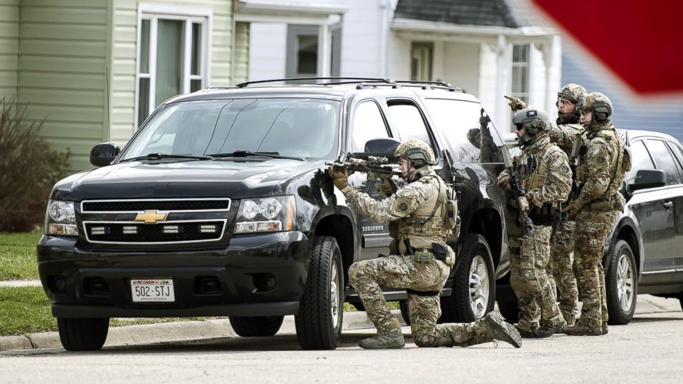 In this Thursday, April 6, 2017, photo, FBI agents provide tactical support to sheriff's detectives during a search for Joseph Jakubowski, in Janesville, Wis.