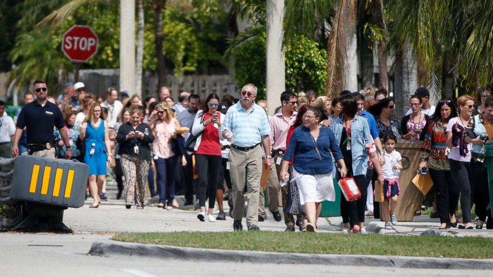 People evacuated because of a bomb threat return to the David Posnack Jewish Community Center and David Posnack Jewish Day School, Feb. 27, 2017, in Davie, Fla.