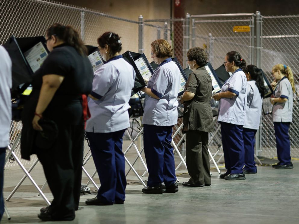 PHOTO: Casino workers vote at an early voting site in Las Vegas, Oct. 26, 2016.