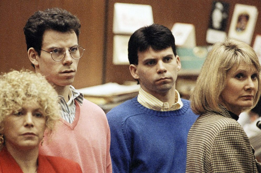 Lyle Menendez, right, and brother Erik listen to a charge of murder conspiracy against them, Dec. 29, 1992, in Los Angeles. The brothers pled innocent to the new indictment which dropped the original charge that they killed their parents for money. The indictment was returned nearly three years after Joseph and Kitty Menendez were found slain in their home.