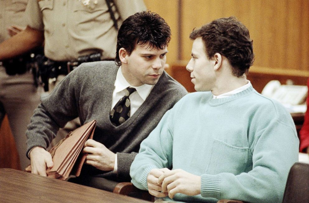 Lyle Menendez, left confers with brother Erik during a court appearance, April 2, 1991, in Beverly Hills, California. Lawyers for the brothers won another delay of a preliminary hearing while they seek a state Supreme Court opinion on whether an alleged murder confession is protected by doctor-patient privilege.