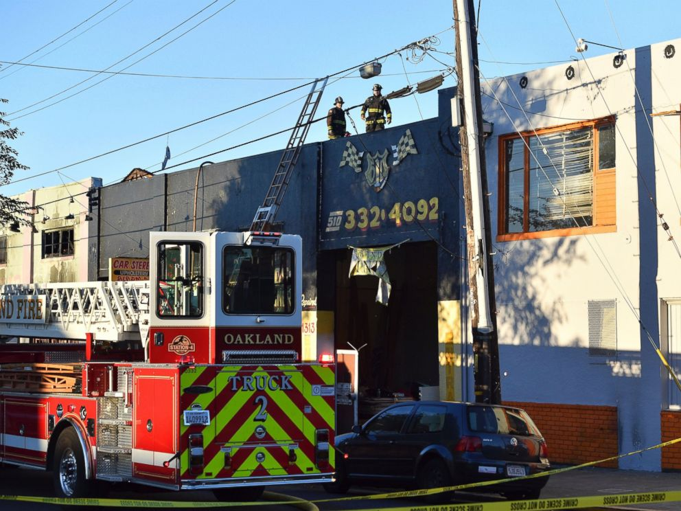 PHOTO: Firefighters assess the scene where a fire tore through a warehouse party, Dec. 3, 2016 in Oakland, California.