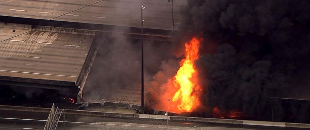 PHOTO: In this aerial image made from a video provided by WSB-TV, a large fire that caused an overpass on Interstate 85 to collapse burns in Atlanta, March 30, 2017.