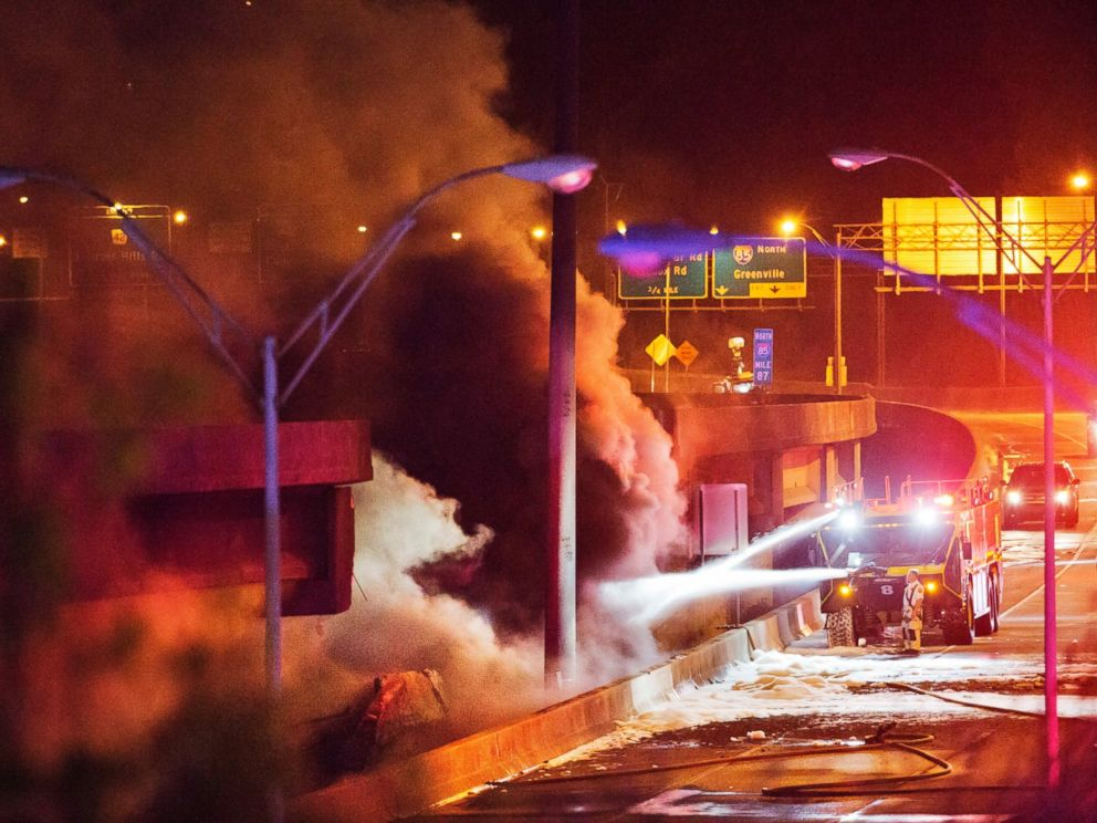 PHOTO: Smoke billows from a section of an overpass that collapsed from a large fire on Interstate 85 in Atlanta, March 30, 2017.