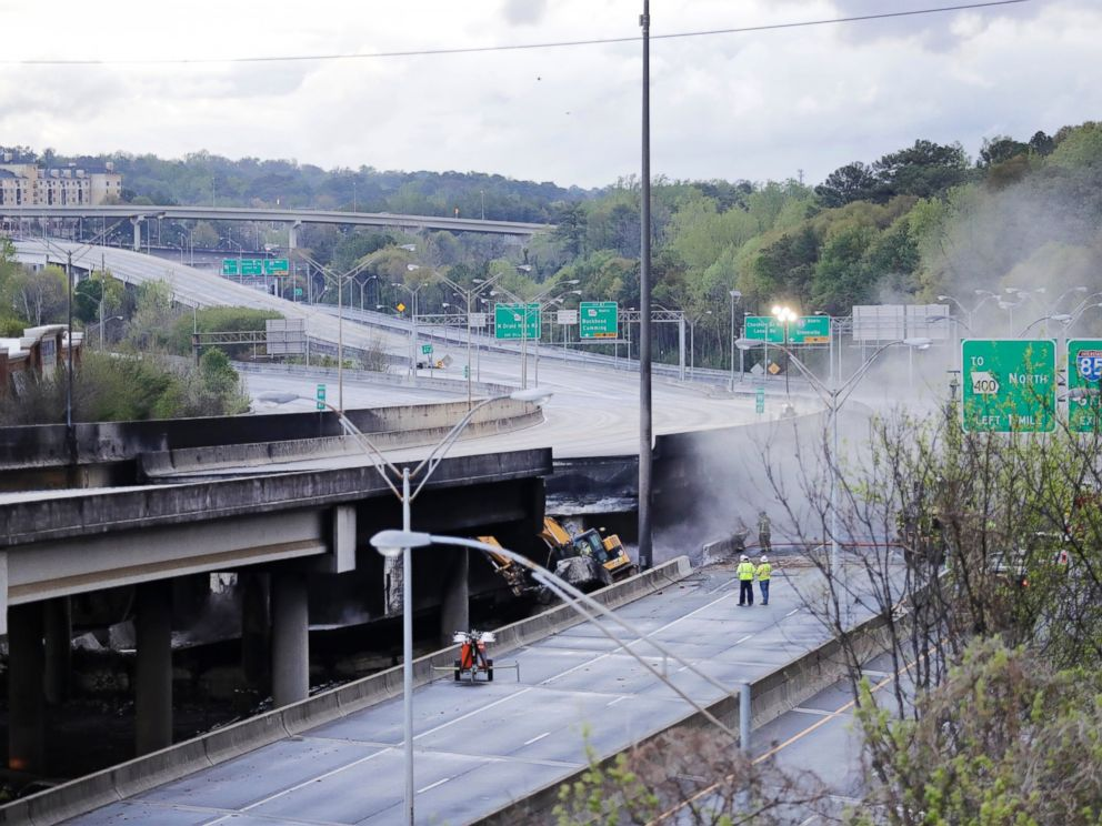 PHOTO: Crews work on a section of an overpass that collapsed from a large fire on Interstate 85 in Atlanta, March 31, 2017.