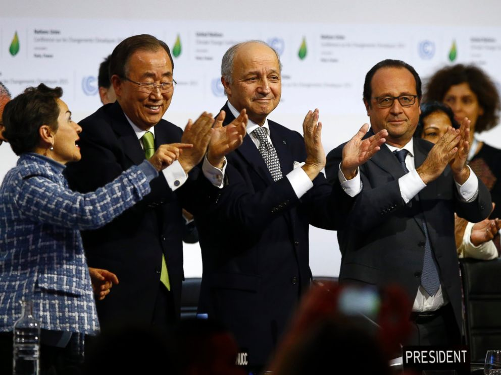 PHOTO: U.N. climate chief Christiana Figueres, U.N. Secretary General Ban ki-Moon, president of the COP21 Laurent Fabius and French President Francois Hollande applaud after the final conference at the COP21, in Le Bourget France, April 22, 2016.