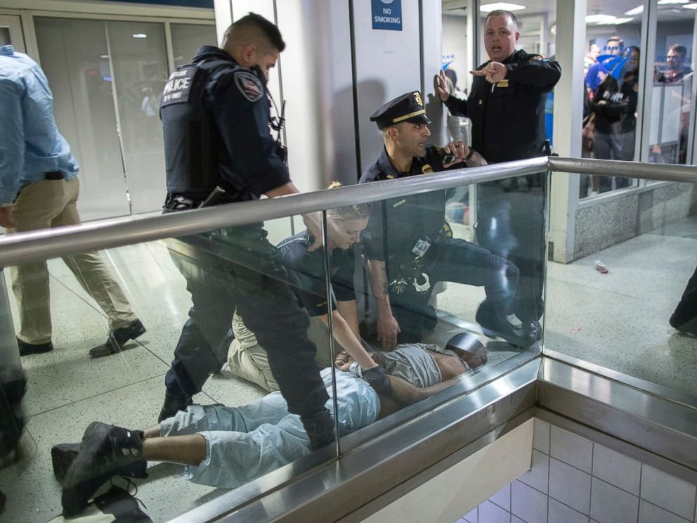 PHOTO: New York City police officers detain a passenger from a disabled New Jersey Transit train at New Yorks Penn Station, April 14, 2017.
