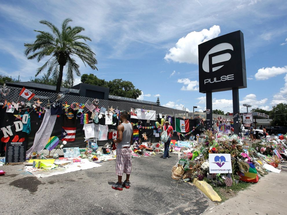 PHOTO: In this July 11, 2016, file photo, visitors at a makeshift memorial outside the Pulse nightclub, the day before the one month anniversary of the mass shooting, in Orlando, Fla.