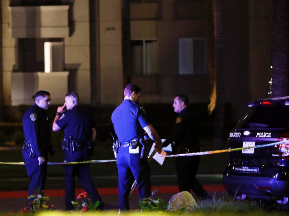 PHOTO: San Diego police officers stand in front of a cordoned off La Jolla apartment after a shooting, April 30, 2017, in San Diego.