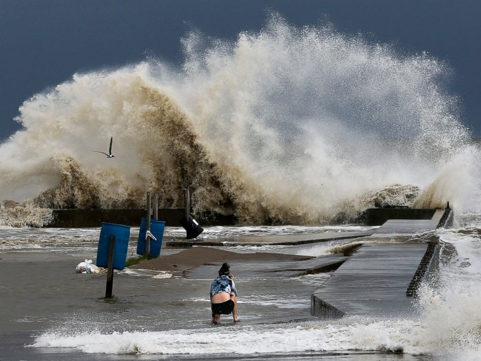 PHOTO: Sydney Schultz takes photos of waves crashing next to Rollover Pass as Tropical Storm Cindy approaches the coast, June 21, 2017 on the Bolivar Peninsula.