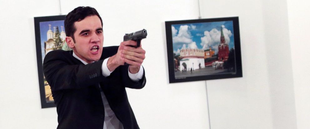 PHOTO: An unnamed gunman gestures after shooting the Russian Ambassador to Turkey, Andrey Karlov, at a photo gallery in Ankara, Turkey, Dec. 19, 2016.