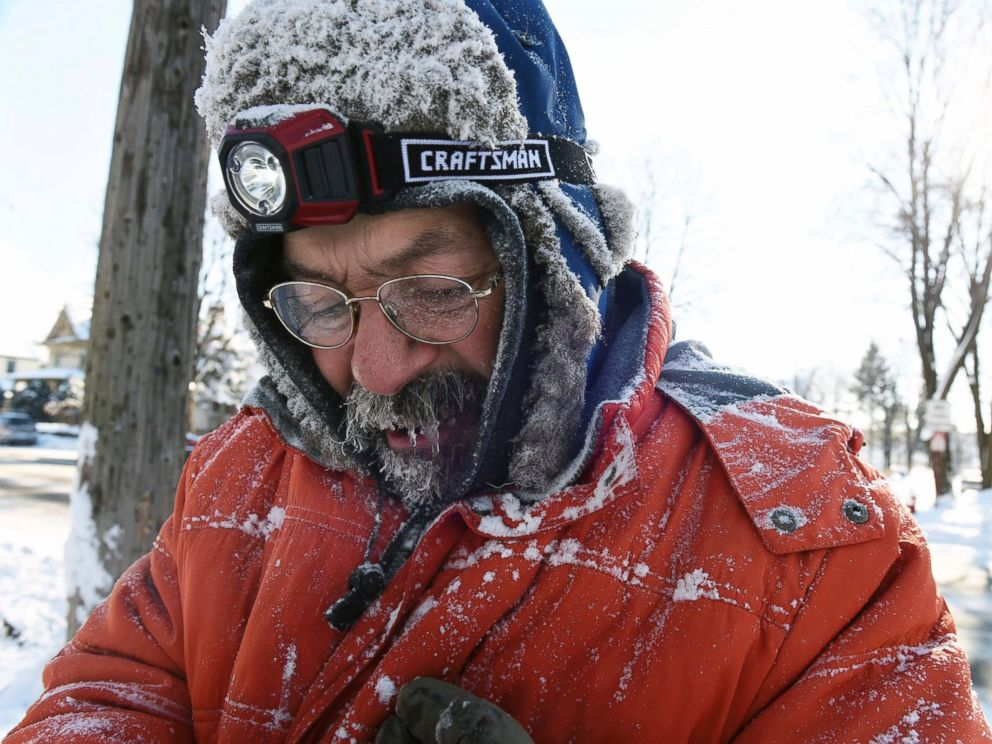 PHOTO: In this Monday, Dec. 12, 2016, photo, ice forms in Carl Bentsons beard and mustache as he clears sidewalks near Colborne Street and St. Clair Avenue in St. Paul, Minnesota.