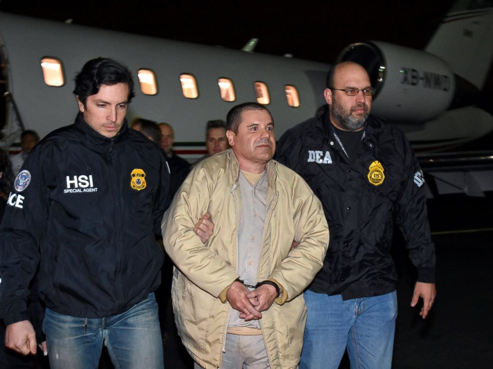 PHOTO: U.S. law enforcement, authorities escort Joaquin El Chapo Guzman from a plane at Long Island MacArthur Airport, Jan. 19, 2017, in Ronkonkoma, New York.