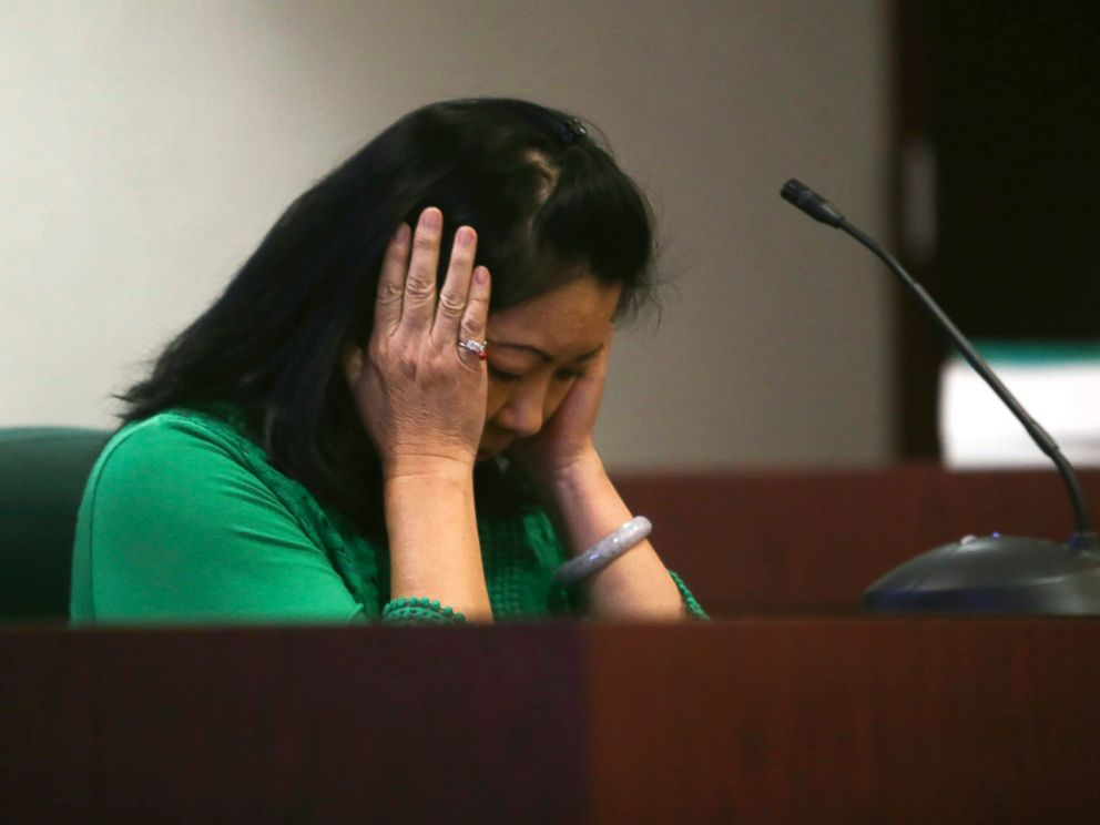 Joanna Turner, a witness, makes a gesture, Feb. 21, 2017, to describe how she saw Curtis Reeves react after shooting Chad Oulson during her testimony at a hearing in the case at the Robert D. Sumner Judicial Center in Dade City, Florida.