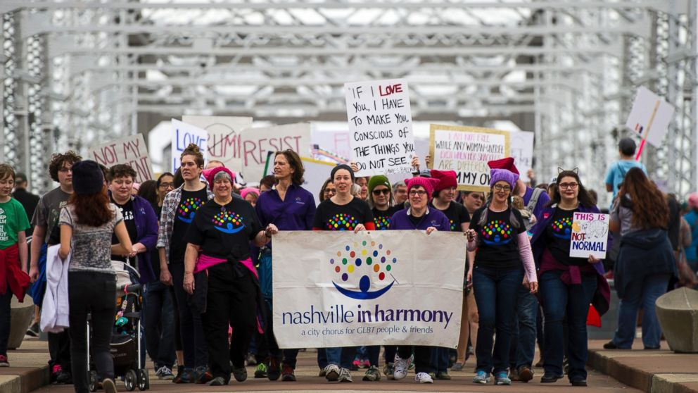 Demonstrators depart from the John Seigenthaler Pedestrian Bridge during a march in solidarity with the Women's March on Washington, Jan. 21, 2017, in Nashville, Tennessee.