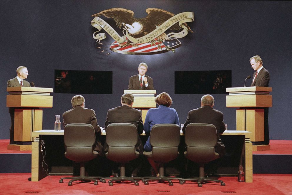 PHOTO: Democratic candidate Bill Clinton, center speaks, while Independent candidate H. Ross Perot, left and U.S. President George Bush look on, during the first debate in St. Louis, Oct. 11, 1992.