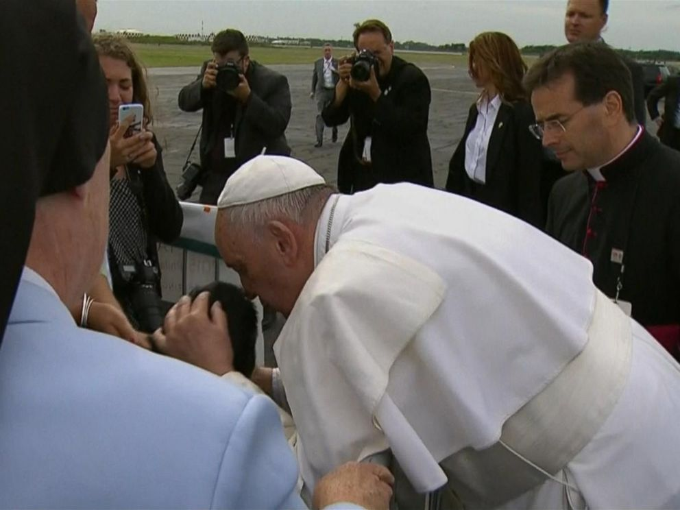PHOTO: Pope Francis kisses a boy in wheelchair after arriving at Philadelphia International Airport in Philadelphia, Sept. 26, 2015.