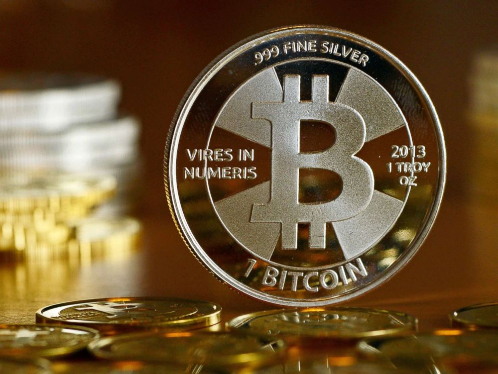 PHOTO: A Bitcoin is pictured at the coin dealer BitcoinCommodities in Berlin, Nov. 28, 2013.