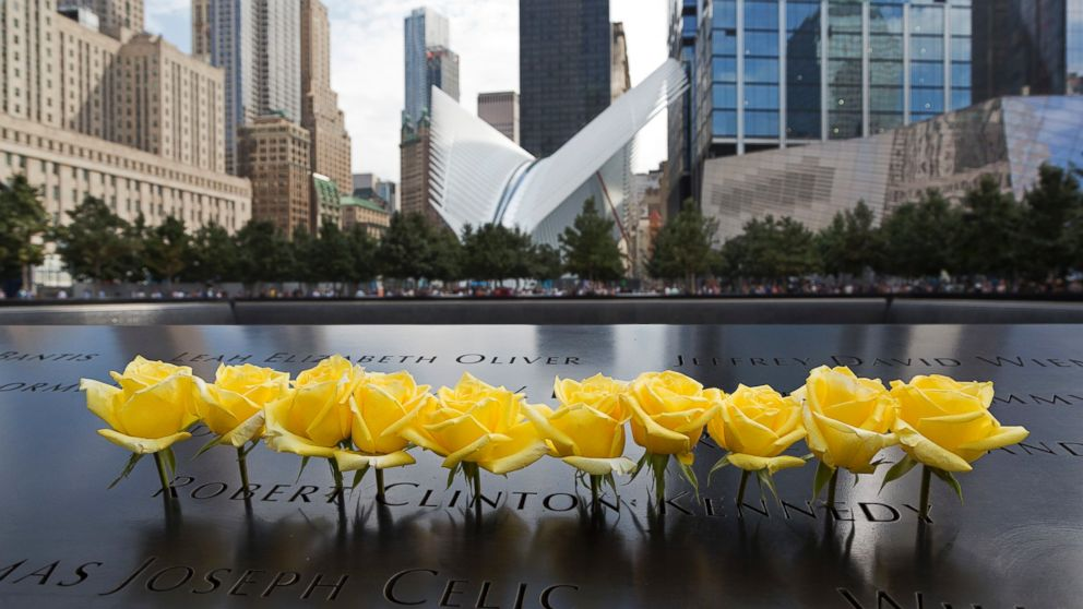 Yellow roses are placed over the name of Robert Clinton Kennedy at the World Trade Center Memorial, Sept. 9, 2016, in New York.
