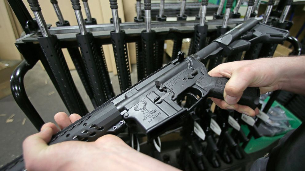 Craftsman Veetek Witkowski holds a newly assembled AR-15-style rifle at the Stag Arms company in New Britain, Conn. on April 10, 2013.