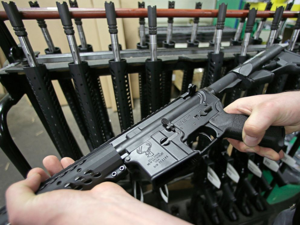PHOTO: Craftsman Veetek Witkowski holds a newly assembled AR-15-style rifle at the Stag Arms company in New Britain, Conn. on April 10, 2013.