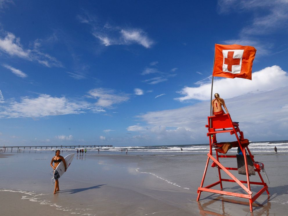 PHOTO: Elise Byrd with the American Red Cross Volunteer Life Saving Corps watches to make sure people venturing into the surf off of Jacksonville Beach, Fla. stayed safe, July 2, 2014.