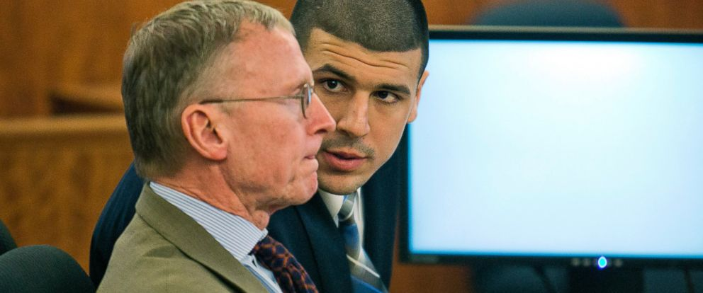 PHOTO: Former NFL player Aaron Hernandez, right, consults with defense attorney Charles Rankin during his murder trial at the Bristol County Superior Court in Fall River, Mass., Feb. 18, 2015.