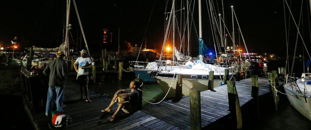 Dauphin Island Regatta sailors gather near their docked sailboats Saturday, April 25, 2015, in Dauphin Island, Ala. Coast Guard officials said they responded to a report of multiple capsized vessels around 4:30 p.m.