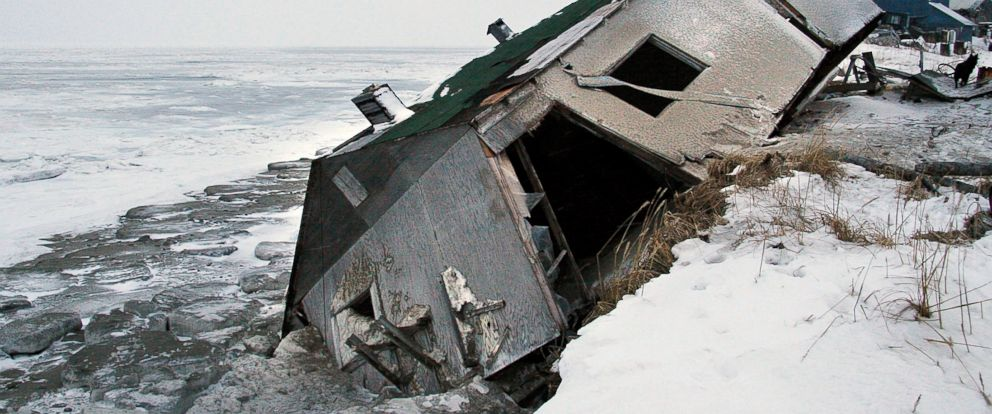 PHOTO: Nathan Weyiouannas abandoned house at the west end of Shishmaref, Alaska, sits on the beach after sliding off during a fall storm in 2005.