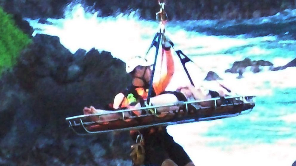 In this May 29, 2016 Rescue workers lift Alexandria Duval, who is also known as Alison Dadow, from the bottom of a cliff on Maui's Hana Highway in Hana, Hawaii.