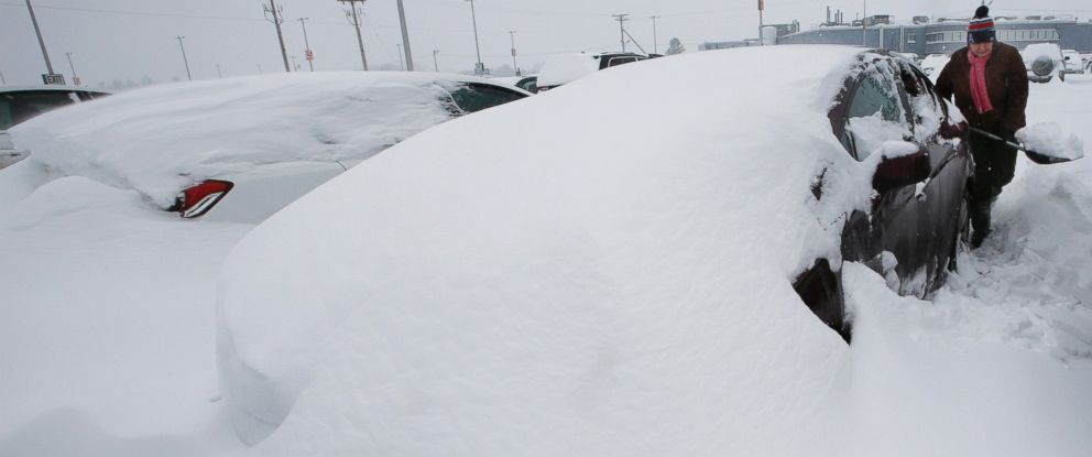 PHOTO: Mary Mulloy of Strafford, Vt., works to dig her car out of the long term parking lot at the Manchester-Boston Regional Airport, Feb. 9, 2015, in Manchester, N.H.