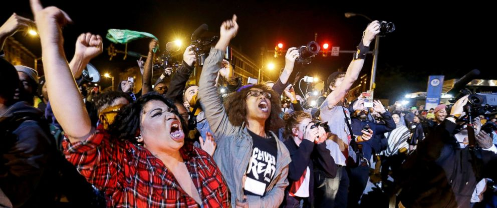 PHOTO: Protesters demonstrate as a curfew imposed in the aftermath of rioting following Mondays funeral for Freddie Gray goes into effect Friday, May 1, 2015, in Baltimore.