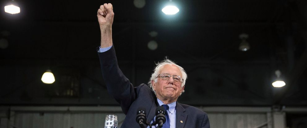Democratic presidential candidate Sen. Bernie Sanders raises his fist to acknowledge the crowd before he speaks during an election night campaign event at the Big Sandy Superstore Arena, April 26, 2016, in Huntington, W.Va.