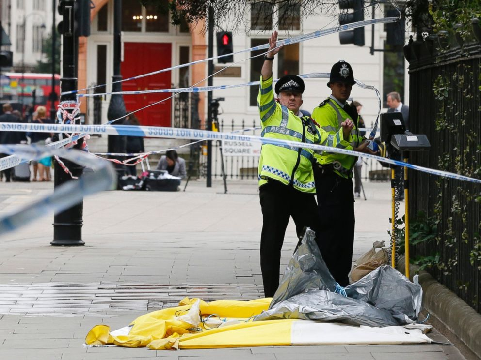 PHOTO: Police forces clear police tape off a knife rampage at Russell Square in London, Aug. 4, 2016.