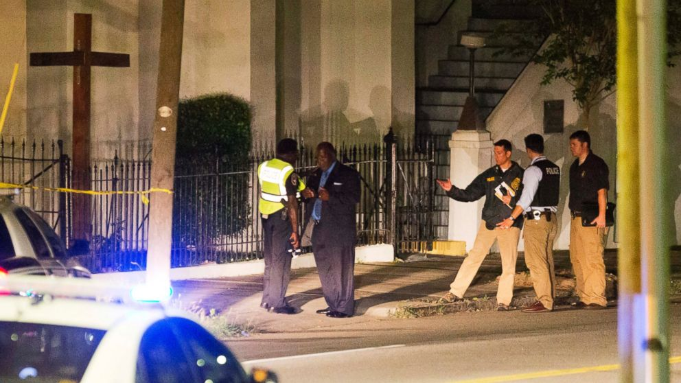 Police stand outside the Emanuel AME Church following a shooting, June 17, 2015, in Charleston, South Carolina.