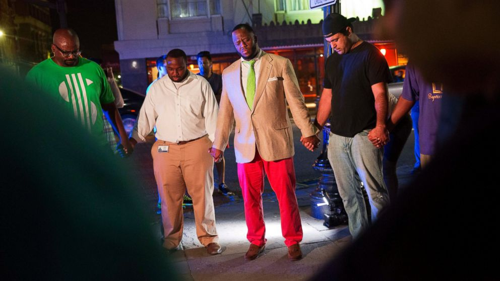 Worshippers gather to pray down the street from the Emanuel AME Church following a shooting, June 17, 2015, in Charleston, South Carolina.