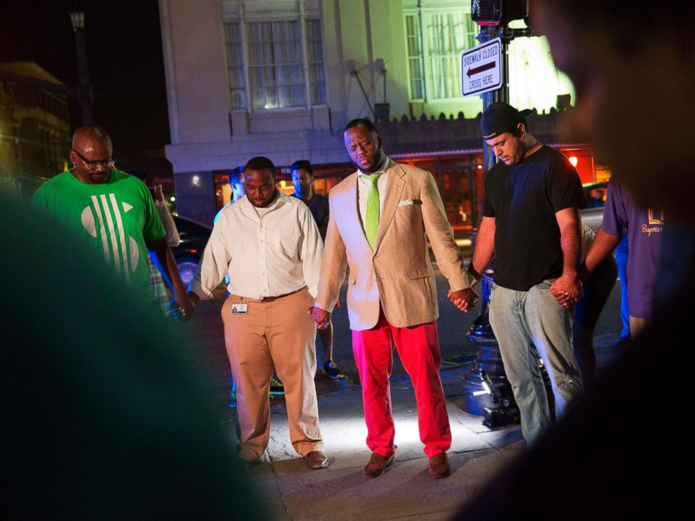PHOTO: Worshippers gather to pray down the street from the Emanuel AME Church following a shooting, June 17, 2015, in Charleston, South Carolina.