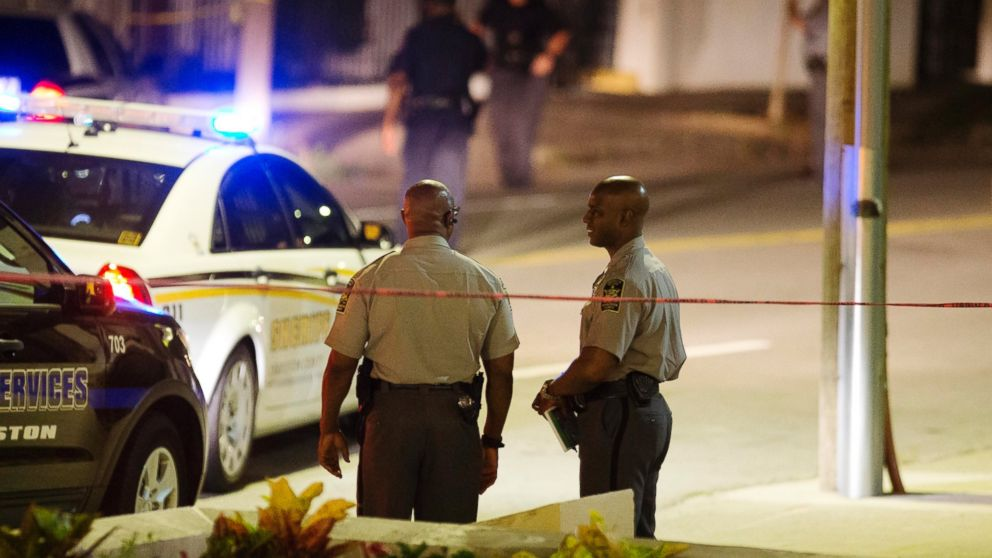 Police stand outside the Emanuel AME Church following a shooting, June 17, 2015, in Charleston, S.C.