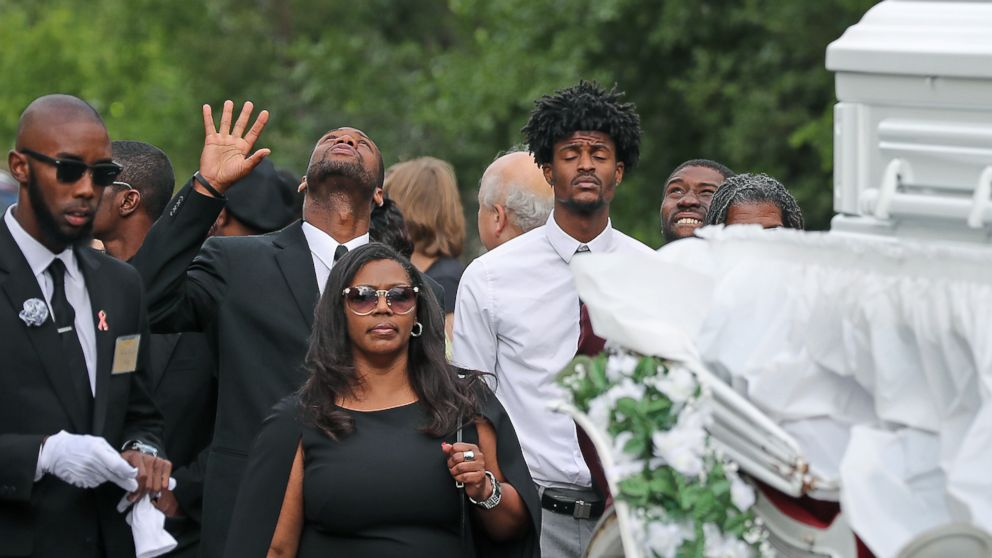 Friends and family follow the funeral procession for Philando Castile as it makes its way along Concordia Avenue to The Cathedral of Saint Paul, July 14, 2016, in St. Paul, Minnesota.