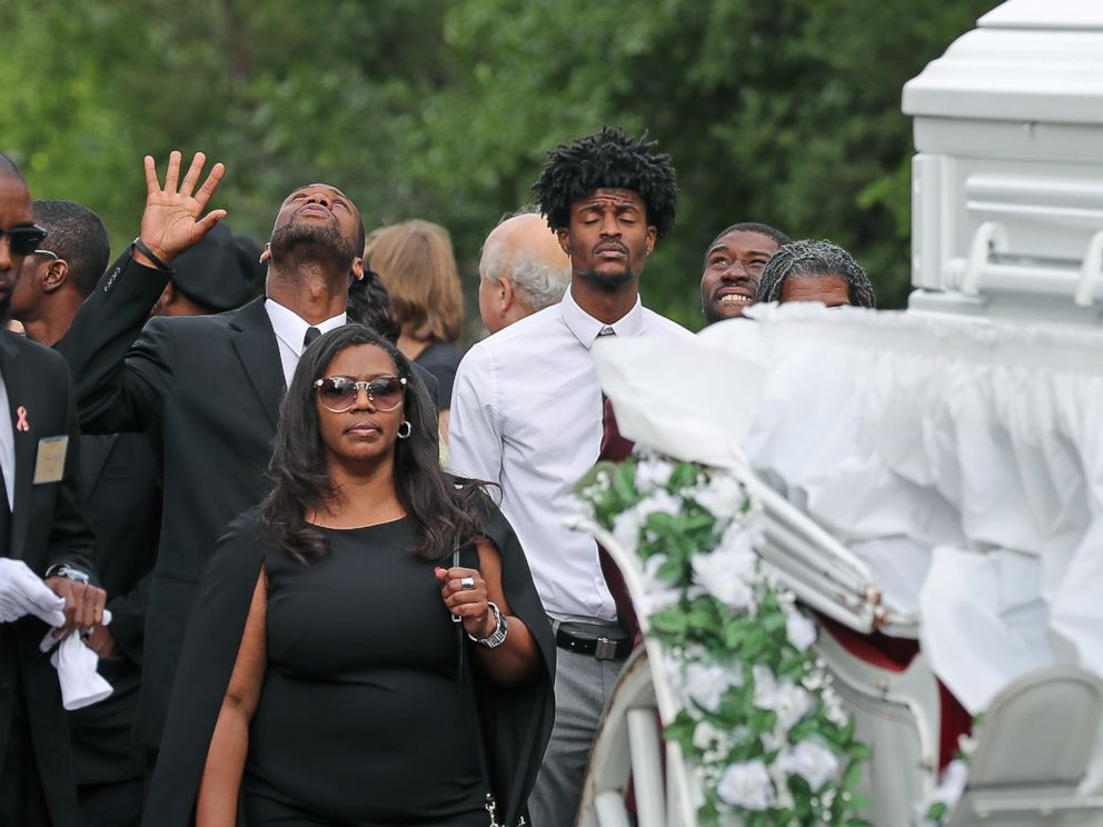 PHOTO: Friends and family follow the funeral procession for Philando Castile as it makes its way along Concordia Avenue to The Cathedral of Saint Paul, July 14, 2016, in St. Paul, Minnesota.