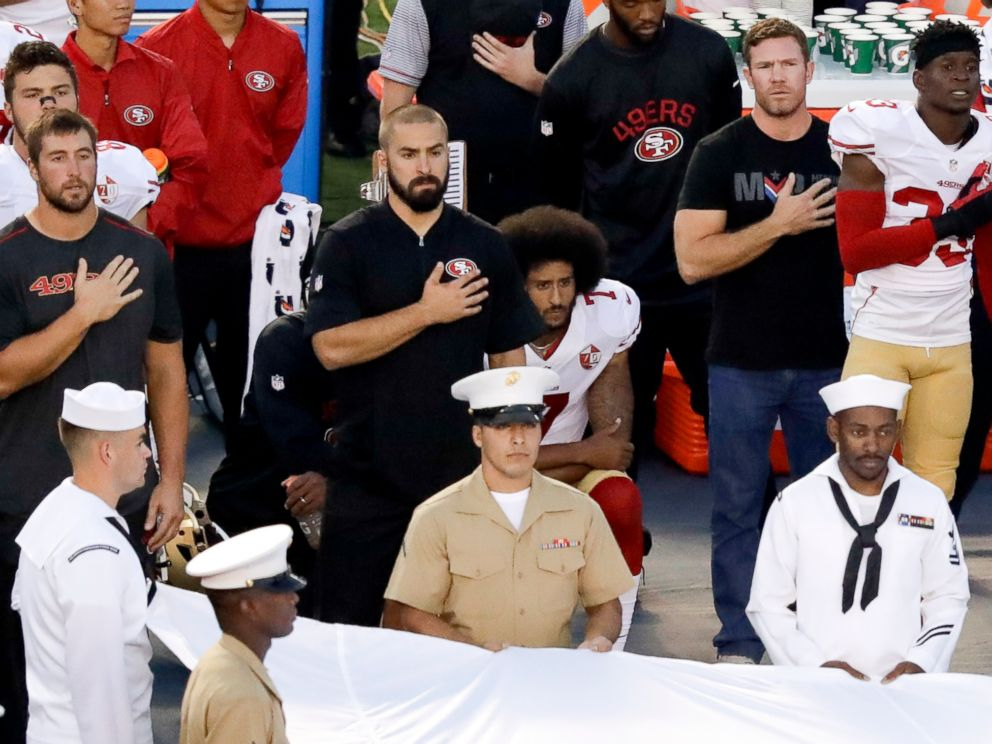 PHOTO: San Francisco 49ers quarterback Colin Kaepernick, middle, kneels during the national anthem before the teams NFL preseason football game against the San Diego Chargers, Sept. 1, 2016, in San Diego.