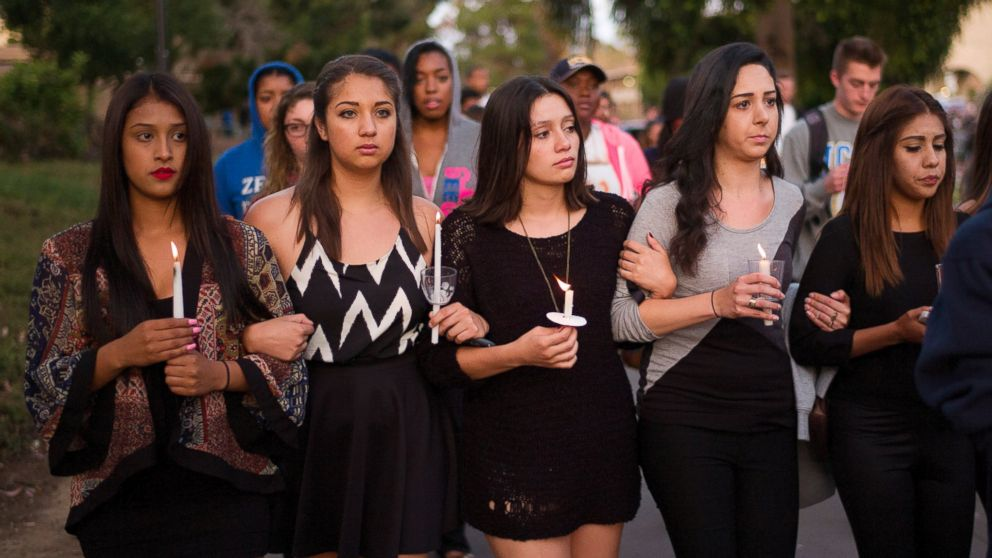 Students march on the campus of the University of California, Santa Barbara during a candlelight vigil held to honor the victims of Friday night's mass shooting on May 24, 2014, in Isla Vista, Calif.