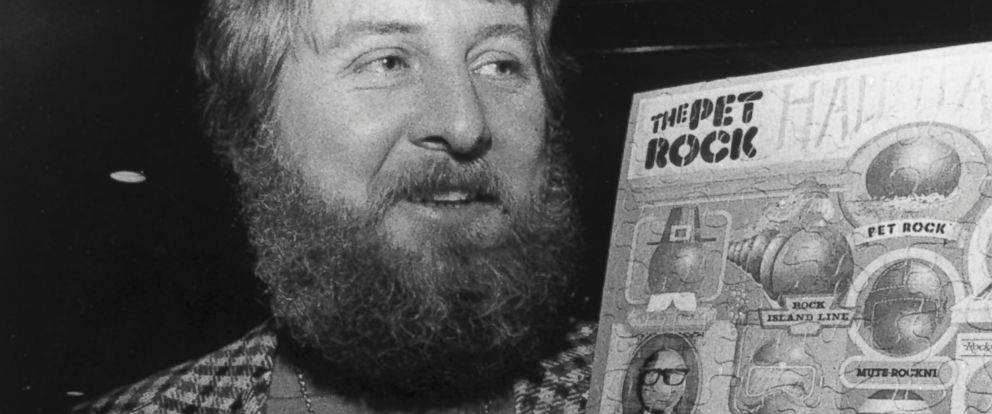 PHOTO: Gary Dahl, originator of the Pet Rock, holds Pet Rock items in 1976.