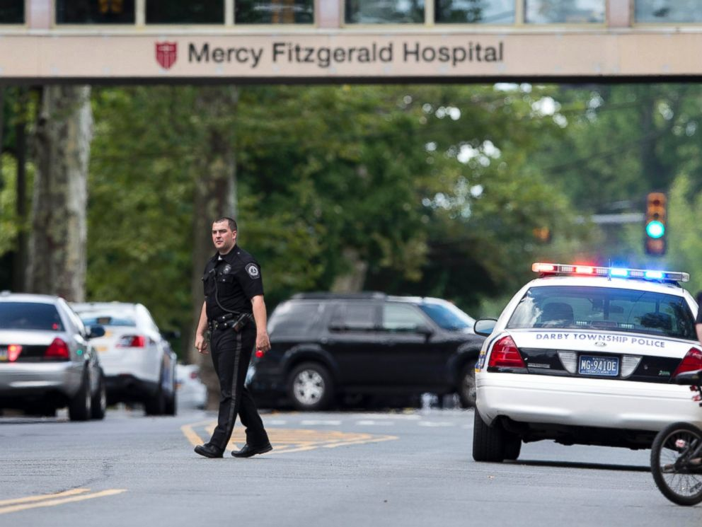 PHOTO: An officer directs traffic near the scene of a shooting Thursday, July 24, 2014, at a wellness center attached to Mercy Fitzgerald Hospital in Darby, Pa.