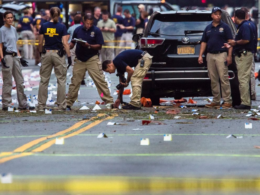 PHOTO: Members of the Federal Bureau of Investigation carry on investigations at the scene of Saturdays explosion on West 23rd Street and Sixth Avenue in Manhattans Chelsea neighborhood, New York, Sept. 18, 2016.