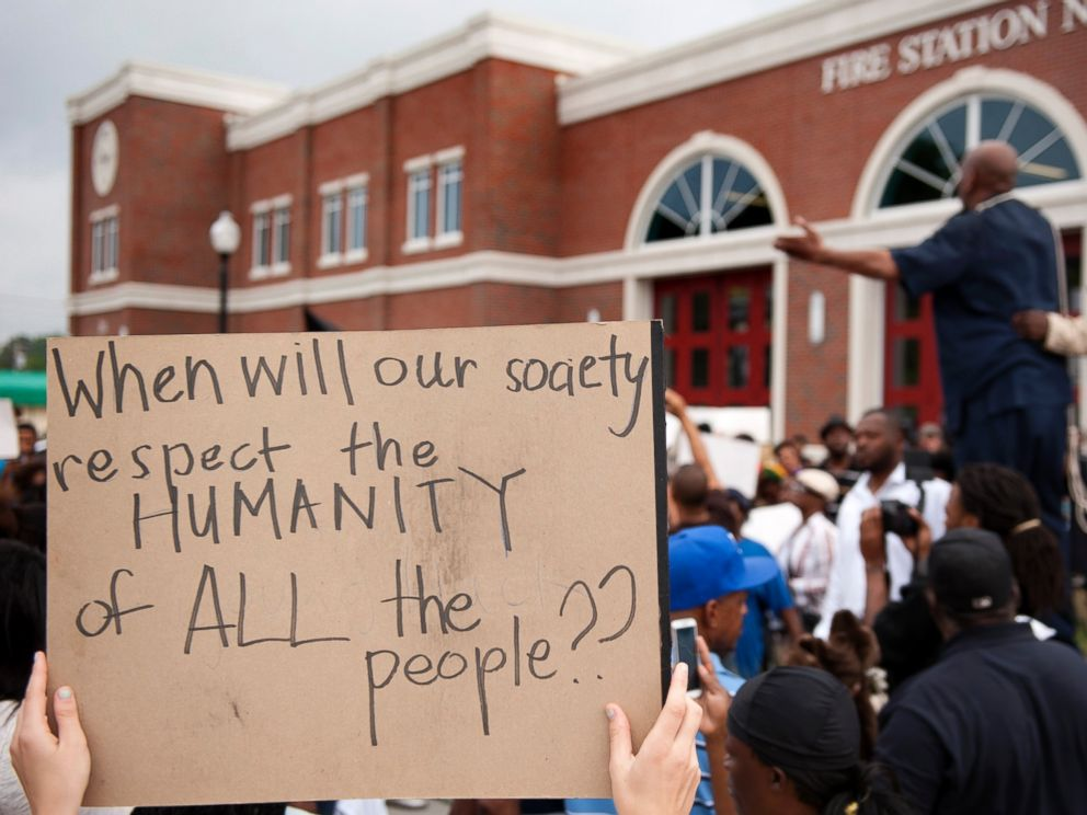 PHOTO: Protestors rally Sunday, Aug. 10, 2014 to protest the shooting of Michael Brown, 18, by police in Ferguson, Mo.
