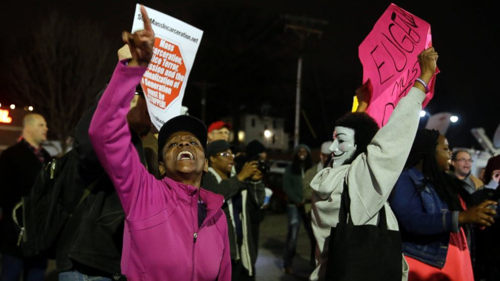 People demonstrate across the street from the Ferguson Police Department, March 12, 2015, in Ferguson, Mo.