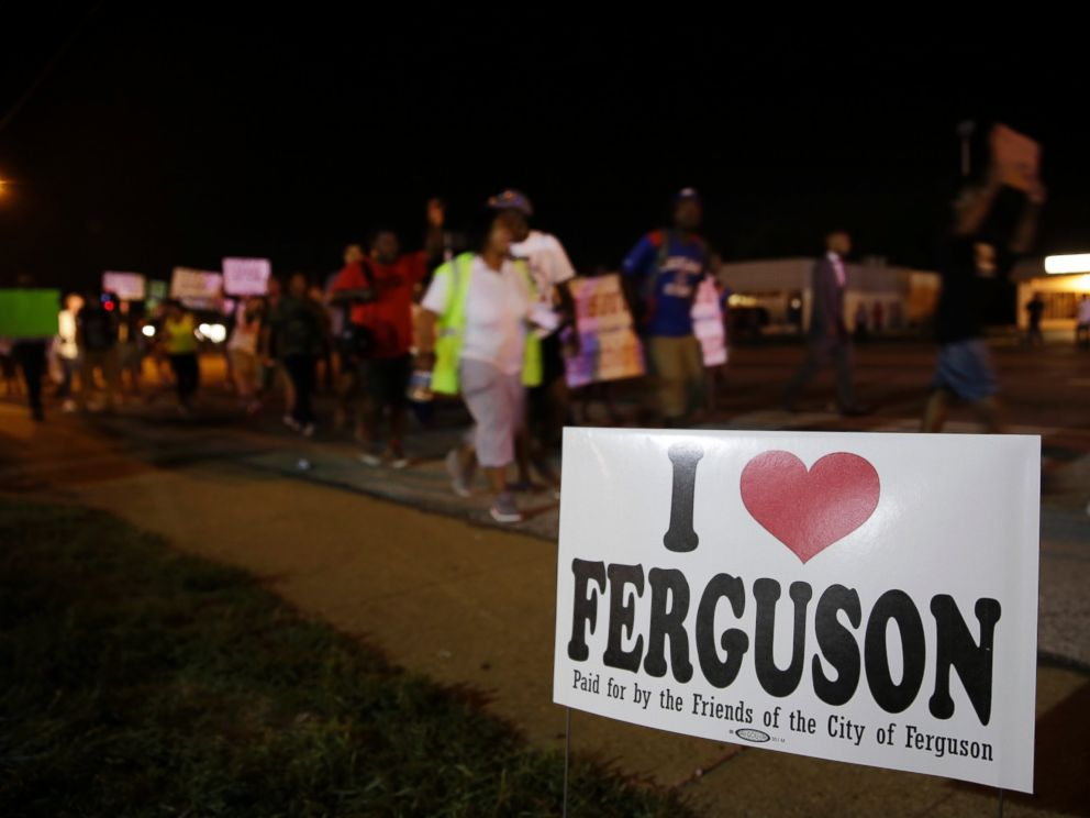 PHOTO: Protesters march, Aug. 21, 2014, in Ferguson, Mo.