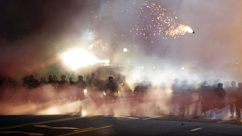 An explosive device deployed by police flies in the air as police and protesters clash, Aug. 13, 2014, in Ferguson, Mo.
