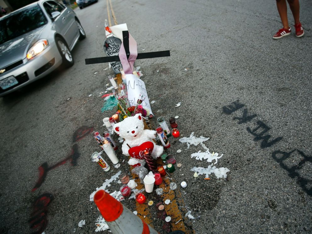 PHOTO: A makeshift memorial sits in the middle of the street where 18-year-old Michael Brown was shot and killed by police, Aug. 11, 2014, in Ferguson, Mo.